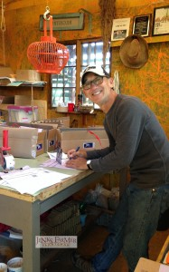 Tom Hall packing bulbs and books in Lushlife International Headquarters (ie the old chicken house)